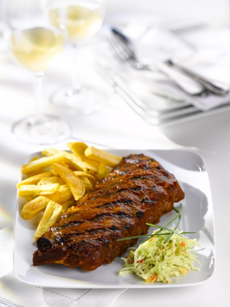 Full Cooked Pork Ribs on Plate with Fries